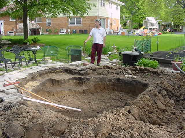A backyard fish pond enlarged 2002 for Pond pump installation